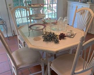 kitchen tile table and four chairs