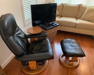 Vintage Ekornes recliner chair with swivel table and matching ottoman. Teak wood frame.  Leather has vintage wear. Unmarked, no label present from the maker.