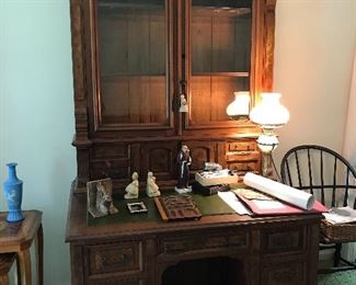 Extraordinary secretary with glass doors and leather topped writing surface.  Hidden compartment