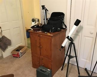 Telescope and cabinet with shelves