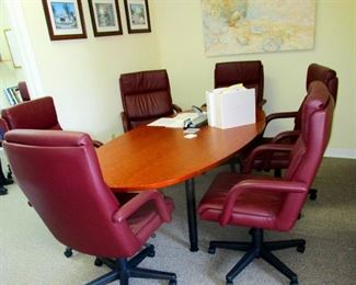 Conference table with six leather swivel chairs