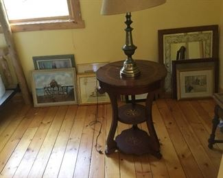 Plenty of art and multiple antique small tables