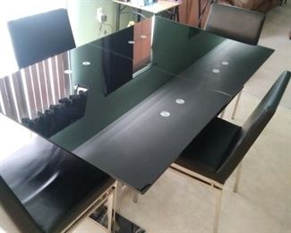 Black lacquer table and four matching chairs