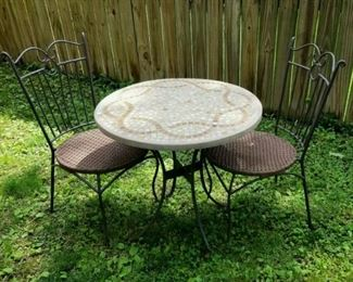 Patio Set; round tile top table with cast iron legs, sturdy outdoor woven rope and wrought iron chairs