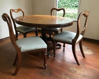Inlaid wood oval dining table with fancy bottom and 4 chairs