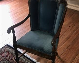 Interesting upholstered chair with faceted back.    $75