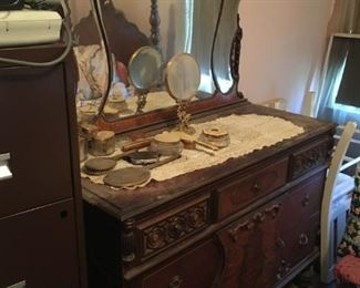 This mirrored dresser can be purchased as part of a set or on its own.