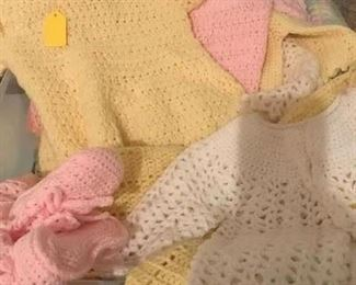 Many crochet baby outfits...sweaters, hats, dresses, booties and etc