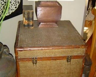 Caned Trunk with leather trim and wood wheels, removable upper tray insert.