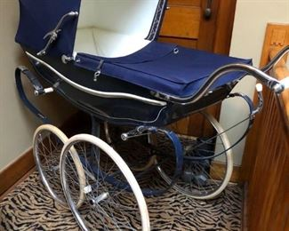English Marmet Pram, very good condition with new suspension belts, brake pads, mattress and cover.  Also has weather cover with wind blind, harness for baby, and diaper bag that attaches under front carriage.  Purchased in 1973, Andersonville Baby shop.