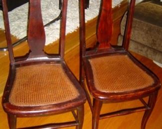 Pair mahogany vintage caned chairs.  Petite but structurally strong.  No breaks in caning.
