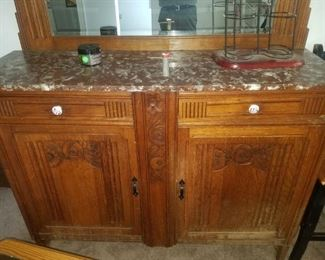 Antique marble-top buffet with mirror