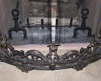 Ornate iron fireplace fender