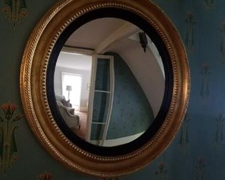 One of two large round gilt wood mirrors