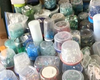Many containers of various size & color beads.