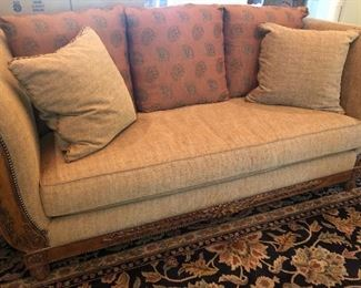 Lovely Lexington upholstered sofa featuring nailhead grommet trim & carved wood detail
