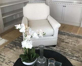 Tessa Accent Chair is from Universal Furniture. The chair is a stylized version of a classic design. It has performance fabric cushions. ( bleach-cleanable fabrics, resist stains, mildew while still remaining remarkably soft to the touch. They're perfect for indoors and outdoors.