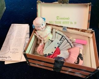 "59. Demisons Doll Trunk and Outfit No.20 Crepe and Tissue Clothes (8"" x 5"" x 3"")"