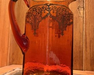 46. Sterling Overlay on Amber Pitcher (10.5'')