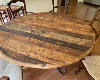 59. Rustic Plank Top Dining Table on Wrought Iron Base (62'' x 31'') 60. 5 French Provincial Ladderback Arm Chairs w/ Rush Seat (23'' x 21'' x 41'')