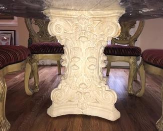 Massive intricately carved creamy beige stone base.