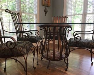 """Gorgeous bronze colored scrolled metal padded chairs and unique open wood & metal base with 42"""" square glass top which is squared off at the ends."""