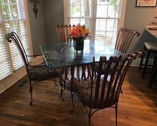 "Scrolled Metal & Wood Base 4-Chair Dining Set. Gorgeous bronze colored scrolled metal padded chairs and unique open wood & metal base with 42"" square glass top which is squared off at the ends."
