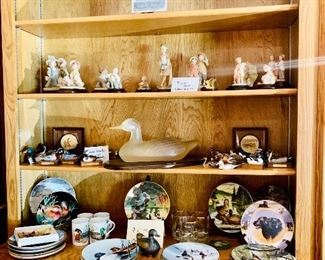 Carved hand-painted ducks plates and statue