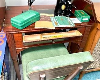 Old singer sewing machine in cabinet  Sewing chair