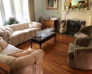 Formal living room with pair of sofas & pair of swivel club chairs