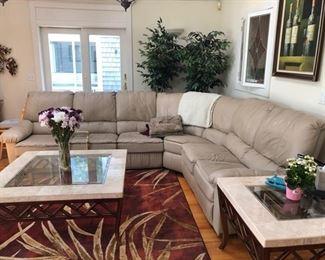Tan leather sectional sofa, area rugs