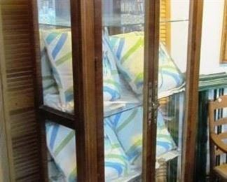Lighted display cabinet, beveled glass doors and sides, glass shelves.