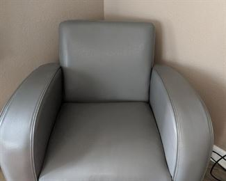 Gray leather chair excellent condition no rips or tears.