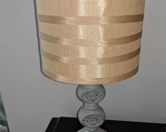 One of two small gray table lamps