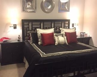 Broyhill 6-piece king-sized bedroom set in black.  Set includes the bed headboard and footboard, the two nightstands with custom-cut glass for protection pictured here, tall dresser/chest, dresser and mirror.  (TempurPedic mattress set is available separately but not included in the bedroom set).