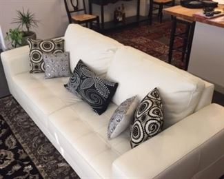 Ivory leather sofa from Copenhagen Imports.  The sofa has a completely finished back making it suitable for floating.  Like new, perfect condition.