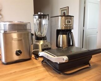 Small kitchen appliances:  Cuisinart ice cream maker, Oster blender