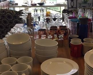 Kitchen items such as pots, pans, small appliances, barware, crystal, glasses, and utensils.