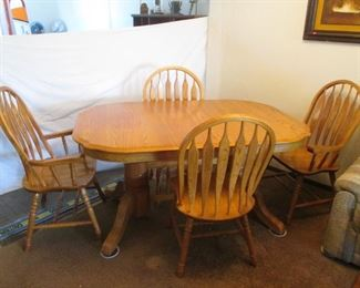 "Dining Room Table/4-Chairs by Oak Arizona.  Includes 2-18"" Leaves which easily slide out from underneath the table top.  Nice Edge Detail on Table Top!                       Size:  60"" X 42"" Plus the 2-Leaves."