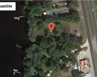 this property is very high on the front next to the highway but may contain some wetlands on the Southwest corner next to the river.