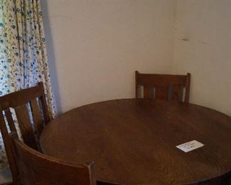 oak table with leaf and 4 chairs
