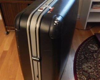 Large luggage on wheels.