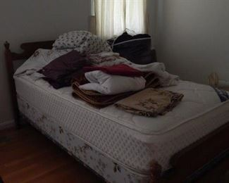Twin bed with linens, bedding and more.