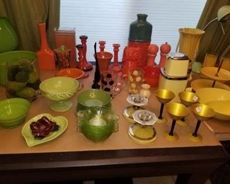 Green, orange and yellow: art deco candle holders, yellow aluminum cocktail glasses, ice crusher, vintage polka-dot mugs
