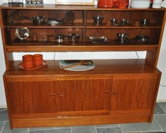 Teak buffet server credenza with lighted hutch. Hutch has sliding glass doors