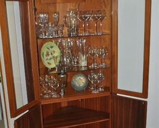 Cabinet glass doors open to 3 shelves with display of glass bar ware and two lower shelves for storage