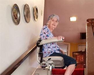 90 year old mom utilizing chair lift. Has remote controls too.