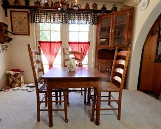 Antique tables and chairs and corner cabinet.