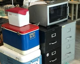 Coolers, file cabinets, microwave, books, lamp, etc.