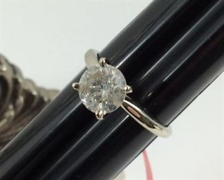 #1.       14 k.  White gold. 1.5 ct Diamond.     $2500.